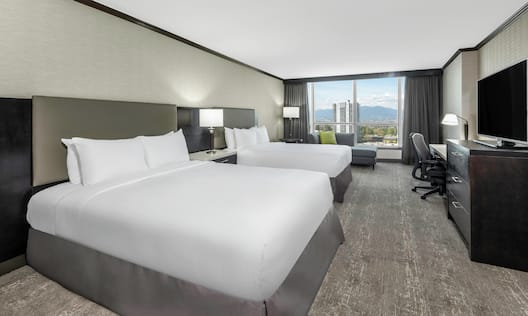 Two Queen Beds Guest Room with HDTV Desk and City View