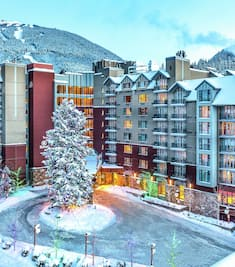 A wintry exterior shot of Hilton Whistler Resort & Spa