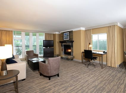 Suite living area with seating, fireplace and TV