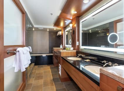 Suite Bathroom with Double Sink and Separate Tub