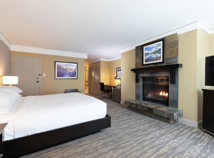 Guest Room with King Bed and Fireplace