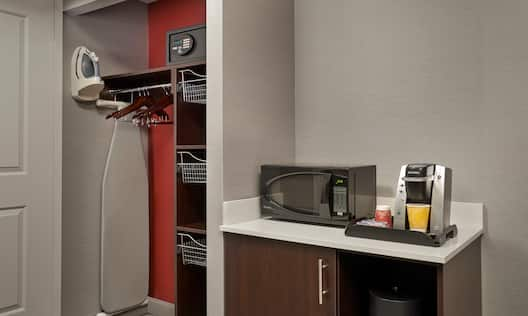 Guest Room Closet With Iron, Ironing Board and Safe, Hospitality Center With Microwave, Keurig, and Mini Fridge