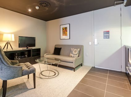 Living Area with chairs, coffee table and tv