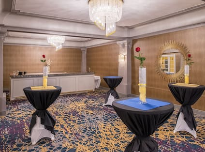 Ballroom with Small Tall Tables and Counter in Back of Room