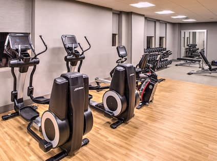 Fitness Center Cross-Trainers, Weight Bench and Dumbbell Rack