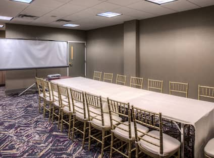 Executive Boardroom with Long Table, Chairs and Projector Screen